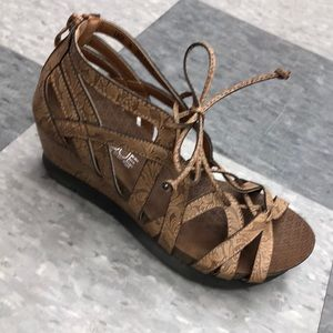 Boutique brown sandals with small wedge heel